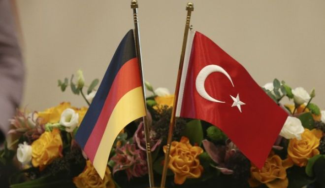 The German and the Turkish flag sit on a table during a press statement of Turkish President Recep Tayyip Erdogan and German Chancellor Angela Merkel after a meeting in Ankara, Turkey, Thursday, Feb. 2, 2017. (AP Photo/Lefteris Pitarakis)