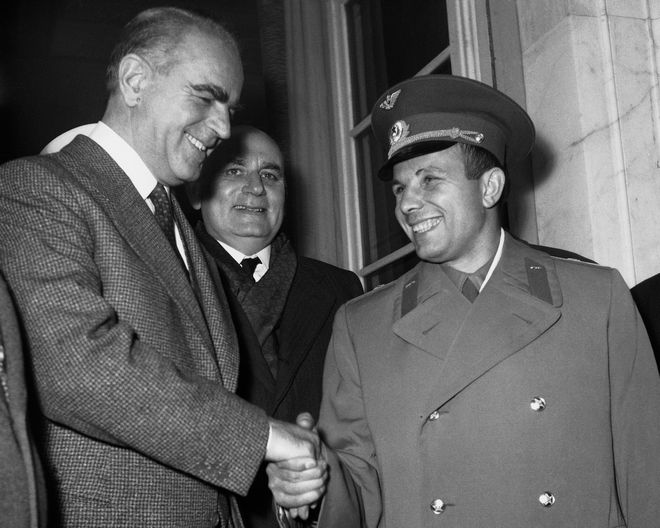 Soviet Astronaut Yuri Gagarin, right, is greeted by Greek Premier Constantine Karamanlis, left, on arriving in Athens, Greece on Feb. 12, 1962, for a three-days visit. Gagarin was made an honorary citizen of Athens. (AP Photo)