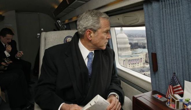 WASHINGTON - JANUARY 20:  In this handout photo provided by the White House, Former U.S. President George W. Bush looks out over the U.S. Capitol as his helicopter departs January 20, 2009 in Washington, D.C.  Bush is heading to Andrews Air Force Base following the inauguration ceremonies for U.S. President Barack Obama.  (Photo by Eric Draper/The White House via Getty Images)