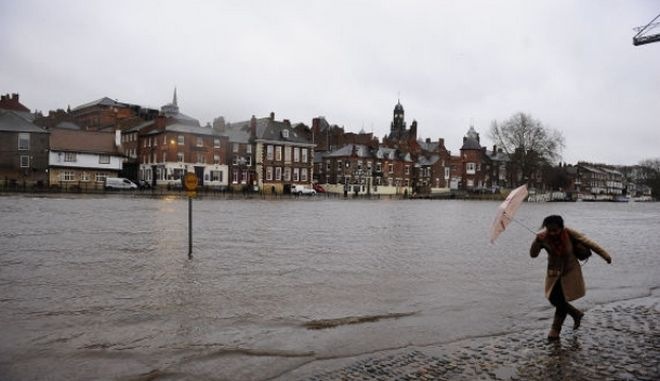 Rising water levels from the River Ouse bring floodwater into riverside roads in York City centre as heavy rain and gales sweep across many parts of the UK. PRESS ASSOCIATION Photo. Picture date: Monday December 23, 2013. See PA story WEATHER Christmas. Photo credit should read: John Giles/PA Wire