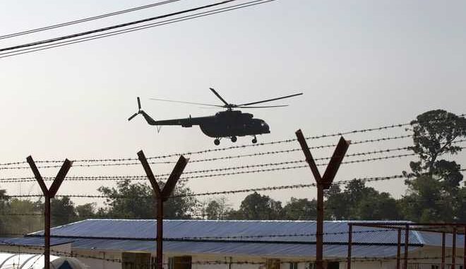 A helicopter carrying an advisory commission with former New Mexico Gov. Bill Richardson lands near newly-built repatriation camps prepared for Rohingya refugees expected to be returning from Bangladesh, Wednesday, Jan. 24, 2018, in Taungpyo township, Maung Daw district, border town of northern Rakhine State, Myanmar. (AP Photo/Thein Zaw)