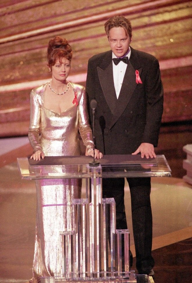 Actress Susan Sarandon and actor Tim Robbins are seen at the podium while presenting at the 65th annual Academy Awards show, in Los Angeles, Calif., on March 29, 1993.  (AP Photo)