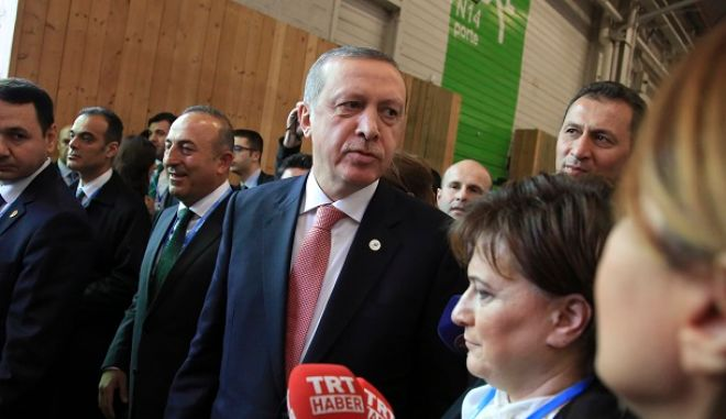 Turkey's President Recep Tayyip Erdogan strolls in the alleys at the COP21, United Nations Climate Change Conference, in Le Bourget, outside Paris, Monday, Nov. 30, 2015.  (AP Photo/Thibault Camus)