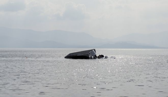 The remains of the boat that was carrying migrants seen off the shore near the Aegean town of Ayvacik, Canakkale, Turkey, Saturday, Jan. 30, 2016.  A boat carrying migrants to Greece hit rocks off the Turkish coast on Saturday and capsized, killing at least 33 people, including five children, officials and news reports said.  Some 75 other migrants were rescued. A Turkish government official said he expects the death toll from the incident to rise as rescue workers try to reach other migrants believed trapped inside the wreckage of the boat which sank shortly after departing from the Aegean resort of Ayvacik.(AP Photo/Halit Onur Sandal)