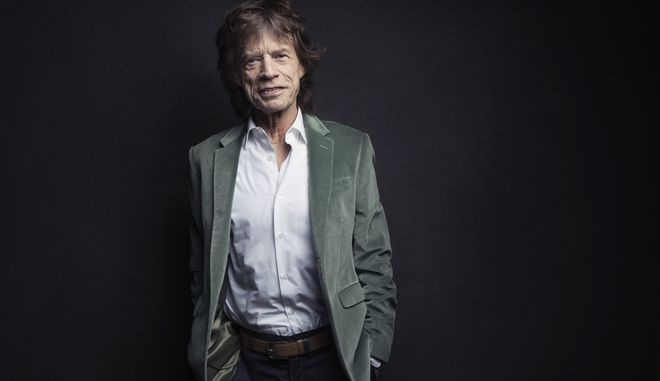 Mick Jagger of the Rolling Stones poses for a portrait on Monday, Nov. 14, 2016, in New York. Jagger was coming up with ideas for an exhibition highlighting The Rolling Stones' five-decade long career, he wanted to re-create the mood of the band in their early years. So, he had a team re-make the first - and messy - London apartment he shared with his band mates in 1962, complete with dirty dishes, beer bottles and blues records placed throughout the flat. (Photo by Victoria Will/Invision/AP)