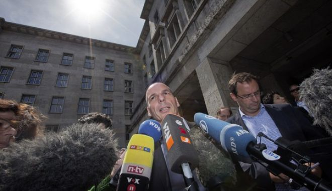 The Finance Minister of Greece, Yanis Varoufakis, addresses the media in front of the finance ministry in Berlin, Germany, Monday, June 8, 2015 after a meeting with German Finance Minister Wolfgang Schaeuble.  (AP Photo/Michael Sohn)