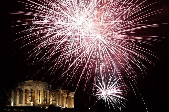 Fireworks explode over the ancient Parthenon temple at the Acropolis Hill  during the New Year's Eve celebrations in Athens, on Wednesday, Jan. 1, 2014. (AP Photo/Petros Giannakouris)