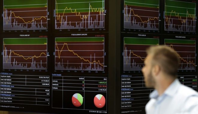 A man looks an index board at the reception hall of the Stock Exchange in Athens, Tuesday, July 25, 2017. Greece is poised to tap international bond markets for the first time in three years in a move the government hopes will signal the country is ready to emerge from its bailout era. (AP Photo/Thanassis Stavrakis)