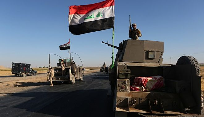 "Federal Iraqi security forces gather outside the Kurdish hold City of Alton Kupri, outskirts of Irbil, Iraq, Thursday Oct. 19. 2017. A Baghdad court has issued an arrest warrant for the vice president of Iraq's Kurdish region for saying Iraqi forces were ""occupying"" the disputed Kirkuk province. (AP Photo/Khalid Mohammed)"