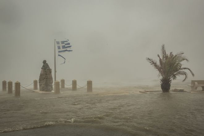 Seawater from crashing waves cover a road at the port of Argostoli, on the Ionian island of Kefalonia, western Greece, Friday, Sept. 18, 2020. Hurricane-force winds and heavy rainfall battered several islands off the western coast of Greece Friday, causing power outages and road closures, as authorities in nearby mainland areas remained on alert. (AP Photo/Nikiforos Stamenis)