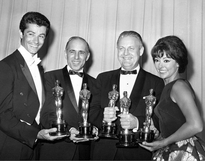 """Oscar winners for """"The West Side Story,"""" George Chakiris, left, Jerome Robbins, Robert Wise and Rita Morena, pose at the Academy Awards in Santa Monica on April 9, 1962.  Chakiris won best supporting actor; Robbins won best director; Wise won as co-director with Robbins and as producer of best picture; and Moreno won best supporting actress.  (AP Photo)"""