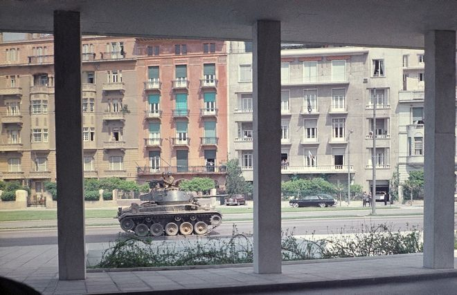 Soldier mans machine gun atop Greek Army Tank on Patrol in downtown Athens April 21, 1967 in the aftermath of a military coup. The photo was taken from hotel window by an American tourist who returned from the Greek Captial to Rome. (AP Photo)