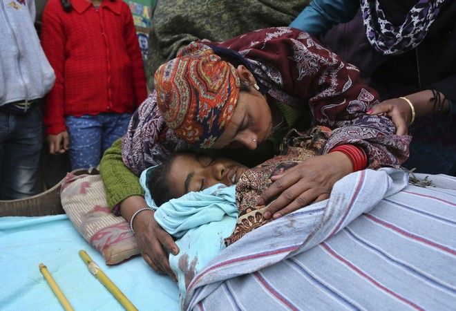 Mother of Indian teenage girl Neelam Devi, wails before her funeral in Pindi in Arnia district of Jammu and Kashmir, India, Thursday, Jan.18,2018. Indian officials say the teenage girl and a soldier have been killed by Pakistani troops firing along the volatile frontier in Indian-controlled Kashmir. (AP Photo/Channi Anand)