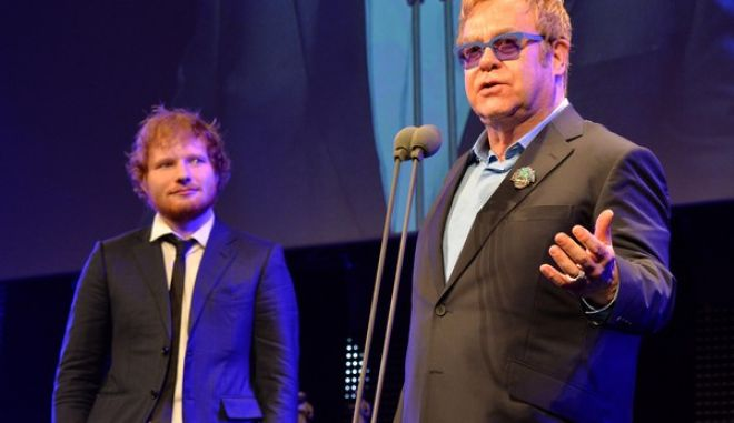 Elton John presents Ed Sheeran the 'Songwriter of the Year' Award at the 60th Ivor Novello Awards at the Grosvenor House in London on Thursday, May 21, 2015.(Photo by Mark Allan /Invision/AP)Sir
