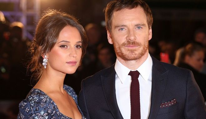 Actors Alicia Vikander and Michael Fassbender pose for photographers upon arrival at the premiere of the film 'The Light Between The Oceans', in London, Wednesday, Oct. 19, 2016. (Photo by Joel Ryan/Invision/AP)