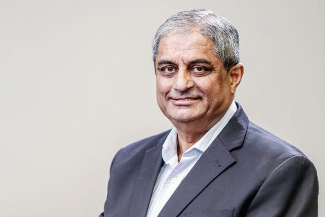Aditya Puri, managing director of HDFC Bank Ltd., poses for a photograph after a Bloomberg Television interview in Mumbai, India, on Thursday, July 20, 2017. India is making good progress in dealing with bad-loans that are weighing down on the country's banks, suggesting long-term valuations for the financial industry are set to improve, according to Puri. Photographer: Dhiraj Singh/Bloomberg via Getty Images