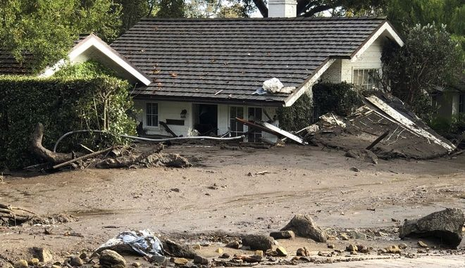 This photo provided by the Santa Barbara County Fire Department shows a home that has been buried in flood debris in Montecito, Calif., Tuesday, Jan. 9, 2018. Several homes were swept away before dawn Tuesday when mud and debris roared into neighborhoods in Montecito from hillsides stripped of vegetation during the Thomas wildfire. (Mike Eliason/Santa Barbara County Fire Department via AP)