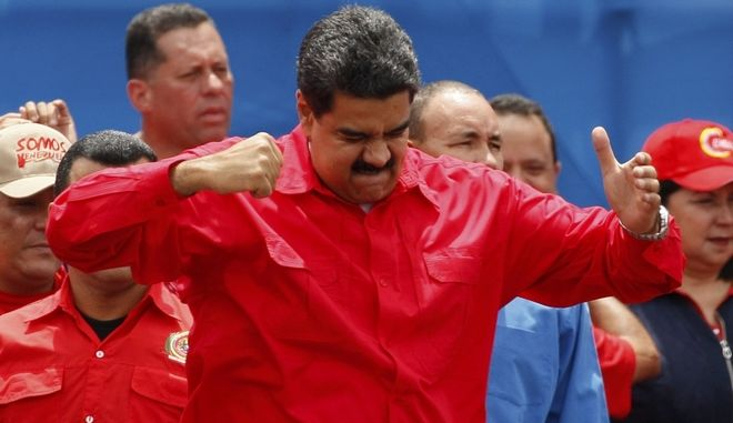 Venezuela's President Nicolas Maduro gestures during a rally in Caracas, Venezuela, Thursday, July 27, 2017. President Maduro has provoked international outcry and enraged an opposition demanding his resignation with his push to elect an assembly that will rewrite the troubled South American nation's constitution. Sunday's election will cap nearly four months of political upheaval that has left thousands detained and injured and at least 100 dead. (AP Photo/Ariana Cubillos)