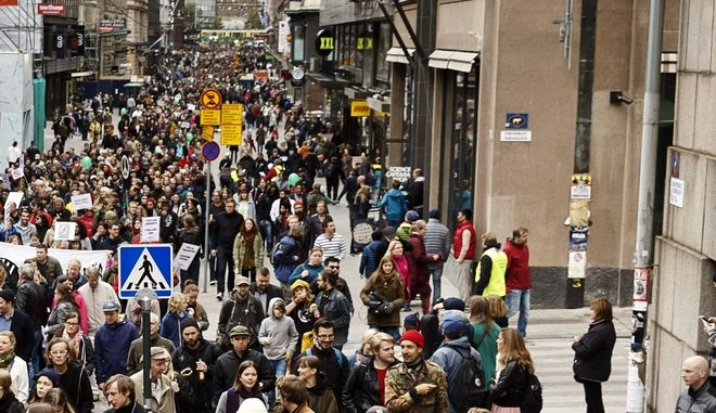 "People demonstrate against racism and fascism in Helsinki, Finland Saturday, Sept. 24, 2016. Tens of thousands of people are demonstrating across Finland under the slogan ""Enough is enough"" following the death of a man who reportedly spit in front of neo-Nazis holding a rally in Helsinki. (Roni Rekomaa/Lehtikuva via AP)"