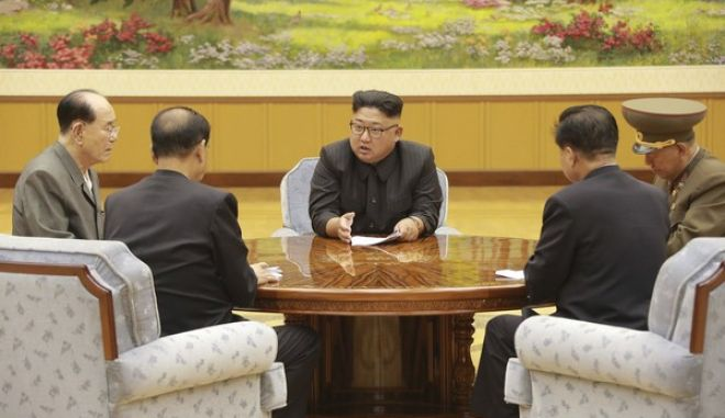 "In this Sept. 3, 2017, image distributed on Monday, Sept. 4, 2017, by the North Korean government, North Korea's leader Kim Jong Un holds a meeting of the ruling party's presidium. North Korea claimed a ""perfect success"" for its most powerful nuclear test so far, a further step in the development of weapons capable of striking anywhere in the United States. Independent journalists were not given access to cover the event depicted in this image distributed by the North Korean government. The content of this image is as provided and cannot be independently verified. (Korean Central News Agency/Korea News Service via AP)"