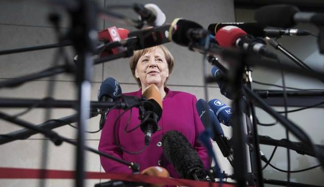 German chancellor Angela Merkel delivers a statement in Berlin, Sunday, Jan. 7, 2018. German Chancellor Angela Merkel embarked Sunday on talks with the center-left Social Democrats on forming a new government, with leaders stressing the need for speed as they attempt to break an impasse more than three months after the country's election. (Joerg Carstensen/dpa via AP)