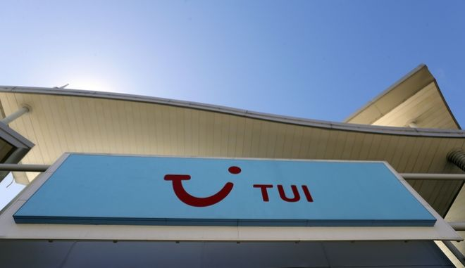 "The sign above a branch of a Tui store in London, Thursday, July 30, 2020. Tui is to close nearly a third of its high street stores in the UK and the Republic of Ireland. The UK's biggest tour operator said the ""difficult"" decision to shut 166 shops is due to the need to cut costs because of the coronavirus pandemic and respond to changes in customer behaviour. (AP Photo/Kirsty Wigglesworth)"