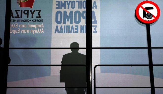 The shadow of SYRIZA's leader is shown next to a road sign that forbides movement to the right. Syriza held a pre election rally at the city of Eleusina with his Leader Alexias Tsipras delivering a speech to a vast audience /                  .