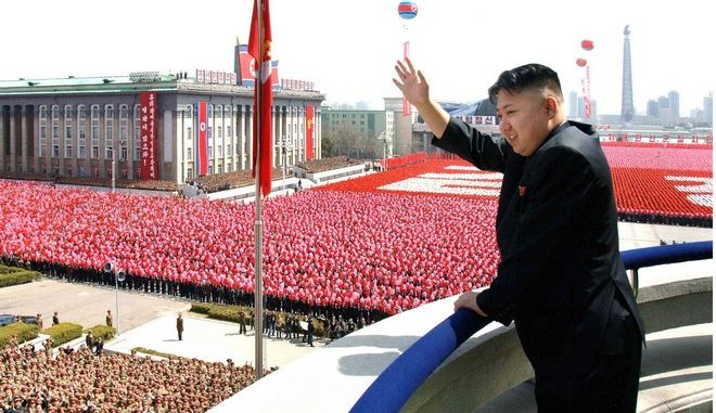 In this Sunday, April 15, 2012 photo released by the Korean Central News Agency and distributed by the Korea News Service on April 16, 2012, North Korean leader Kim Jong Un acknowledges cheers during a mass military parade in Kim Il Sung Square to celebrate the centenary of the birth of his grandfather, national founder Kim Il Sung in Pyongyang, North Korea. (AP Photo/Korean Central News Agency via Korea News Service) JAPAN OUT UNTIL 14 DAYS AFTER THE DAY OF TRANSMISSION