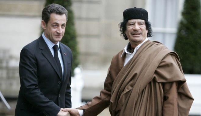 Nicolas Sarkozy, Moammar Gadhafi (AP Photo/Francois Mori)