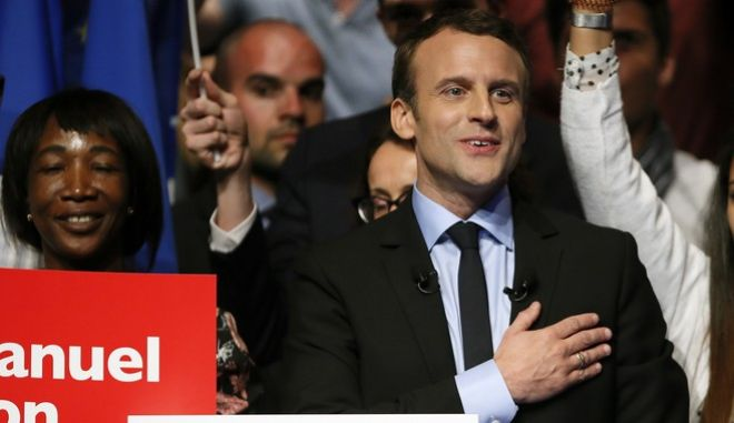 French centrist presidential election candidate Emmanuel Macron reacts after his delivers a speech at a meeting in Pau, southwestern France, Wednesday, April 12, 2017. The two-round presidential election is set for April 23 and May 7. (AP Photo/Bob Edme)