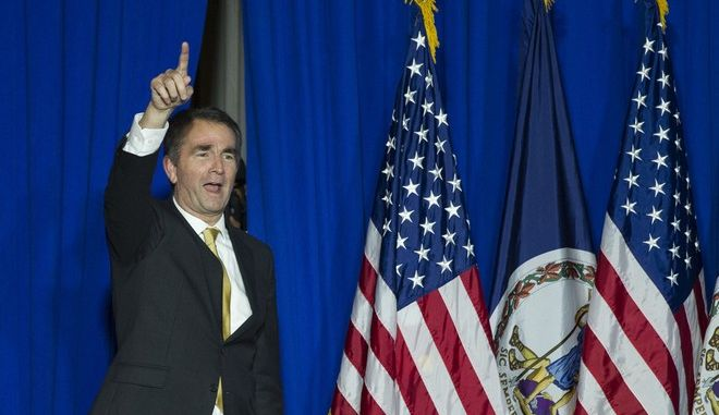 Virginia Democratic Gov. elect Ralph Northam walks onstage to celebrate his election at the Northam For Governor election night party at George Mason University in Fairfax, Va., Tuesday, Nov. 7, 2017. Northam defeated Republican Ed Gillespie. (AP Photo/Cliff Owen)