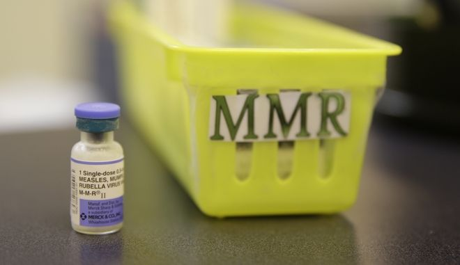 FILE- This Feb. 6, 2015, file photo shows a measles vaccine is shown on a countertop at the Tamalpais Pediatrics clinic in Greenbrae, Calif. The Australian government has ramped up pressure on parents who oppose vaccination by threatening to withhold child care and other payments from families that fail to immunize their children. (AP Photo/Eric Risberg, File)