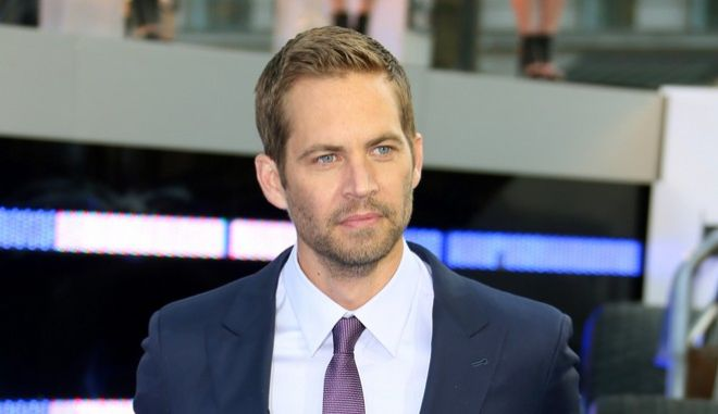 "FILE - In this May 7, 2013, file photo, actor Paul Walker arrives for the World Premiere of ""Fast & Furious 6,"" in central London. Walker's brother, Caleb, told ""Entertainment Tonight"" in a story published online on Sept. 15, 2016, that he has had a discussion with franchise co-star Vin Diesel about and when they may be able to bring Paul Walkers character, Brian OConner, back for a cameo. Paul Walker died in a November 2013 car accident. (Photo by Joel Ryan/Invision/AP, File)"