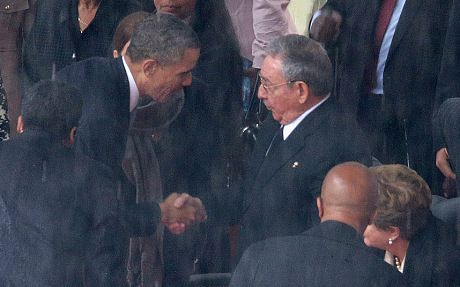 The Official Memorial Service For Nelson Mandela Is Held In Johannesburg...JOHANNESBURG, SOUTH AFRICA - DECEMBER 10:  U.S. President Barack Obama (L) shakes hands with Cuban President Raul Castro during the official memorial service for former South African President Nelson Mandela at FNB Stadium December 10, 2013 in Johannesburg, South Africa. Over 60 heads of state have travelled to South Africa to attend a week of events commemorating the life of former South African President Nelson Mandela. Mr Mandela passed away on the evening of December 5, 2013 at his home in Houghton at the age of 95. Mandela became South Africa's first black president in 1994 after spending 27 years in jail for his activism against apartheid in a racially-divided South Africa.  (Photo by Chip Somodevilla/Getty Images)