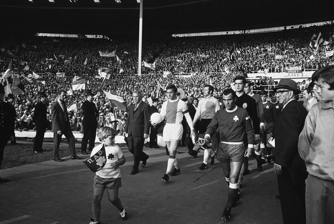 The captains lead out the two teams for the start of the Final of the European Football Champion Club's Cup between Panathinaikos of Greece and Ajax of Amsterdam. Ajax defeated the Greek team 2-0 at Wembley Stadium, London, on June 2, 1971. (AP Photo)