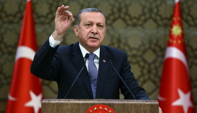 """Turkey's President, Recep Tayyip Erdogan, addresses local administrators at his palace in Ankara, Turkey, Wednesday, Feb. 24, 2016. Erdogan says his country supports the cease-fire agreement for Syria """"in principle"""" but voices serious concern that the proposed truce will strengthen Syrian President Bashar Assad and lead to """"new tragedies."""" Erdogan also said a U.S.-backed Syrian Kurdish militia group  which Turkey regards as a terror organization  should also be kept outside of the scope of the agreement. (Presidential Press Service/Kayhan Ozer, Pool via AP )"""
