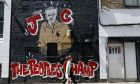 A woman walks past a Jeremy Corbyn mural in Camden, London on Thursday, June 1, 2017. After a career marked more by his appearance at peace marches and union rallies than speeches in Parliament, Jeremy Corbyn, the bearded 68-year-old who promotes the socialism of the 21st century, is trying to overcome skepticism about his leadership in a national election that will determine how the country exits the European Union. (AP Photo/Frank Augstein)