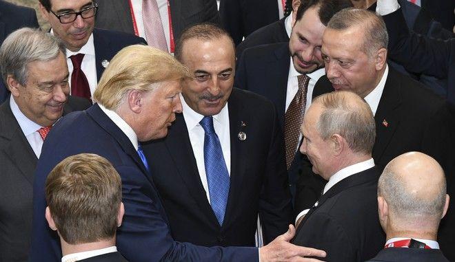 Ο Ντόναλντ Τραμπ μαζί με τον Βλαντίμιρ Πούτιν, τον Ρετζέπ Ταγίπ Ερντογάν, τον Μελβούτ Τσαβούσογλου και τον Αντόνιο Γκουτέρες