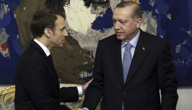 French President Emmanuel Macron, left, and Turkish President Recep Tayyip Erdogan shake hands before their talks at the Elysee Palace in Paris, Friday, Jan. 5, 2018. Erdogan is traveling to Paris for talks with Macron amid protests over press freedom and the deteriorating state of human rights in Turkey. (Yasin Bulbul/Pool Photo via AP)