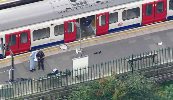 In this aerial image made from video, forensic officers work at the Parsons Green Underground Station after an explosion in London Friday, Sept. 15, 2017. A reported explosion at a train station sent commuters stampeding in panic, injuring several people at the height of London's morning rush hour, and police said they were investigating it as a terrorist attack. (Pool via AP)