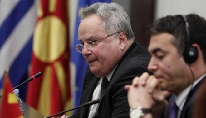 Greece's Foreign Minister Nikos Kotzias talks to the media during a news conference with his Macedonian counterpart Nikola Dimitrov, right, after their meeting at the foreign ministry building in Skopje, Macedonia, Friday, March 23, 2018. Greece's foreign minister arrived in Macedonia for talks on resolving a decades-long dispute over the former Yugoslav republic's name. (AP Photo/Boris Grdanoski)