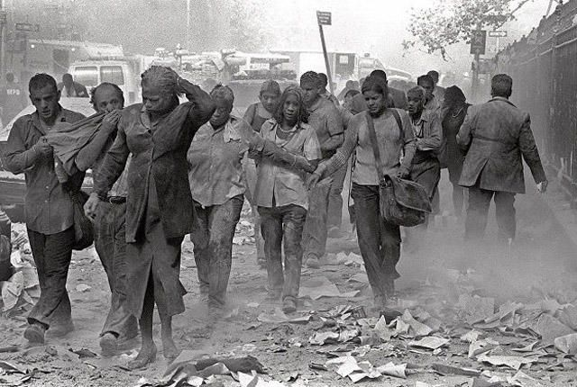 ** FOR USE AS DESIRED IN CONNECTION WITH SEPT. 11 ANNIVERSARY--FILE **People make their way amid debris near New York's World Trade Center in this Sept. 11, 2001 file photo. (AP Photo/Gulnara Samoilova, File)   Original Filename: SEPT_11_NY459.jpg