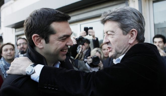 Greece's left-wing opposition leader Alexis Tsipras, left, is welcomed by French far-left leader Jean-Luc Melenchon in Paris, Monday, Feb. 3, 2014. Tsipras and Melenchon met to discuss Tsipras' candidacy to be president of the European commission. (AP Photo/Thibault Camus)