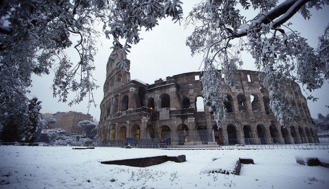 The ancient Colosseum is blanketed in snow in Rome, Monday, Feb. 26, 2018. (AP Photo/Alessandra Tarantino)
