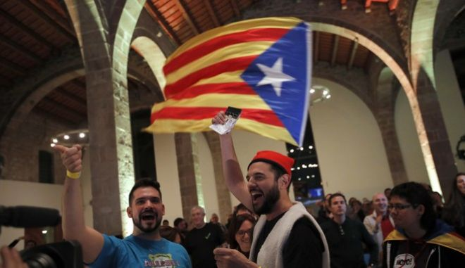 Pro-independence supporters celebrate at the ANC ( Catalan National Assembly ) headquarters after results of the regional elections in Barcelona, Spain, Thursday, Dec. 21, 2017. The pro-secession bloc won a majority but the anti-independence Ciutadans (Citizens), led by 36-year-old lawyer Ines Arrimadas, won the highest number of votes for a single party. ANC is Catalan pro independence platform promoting the political independence of Catalonia.(AP Photo/Emilio Morenatti)