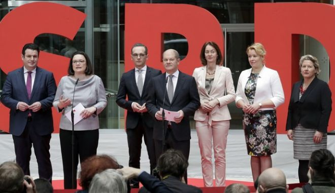 The party's designated leader W:DAndrea Nahles, 2nd left, presents, from left, the designated federal ministers of the German Social Democratic party (SPD), Hubertus Heil (Labor), Heiko Maas (Foreign Affairs), Olaf Scholz (Finance), Katarina Barley (Justice), Franziska Giffey (Family) and Svenja Schulze (Environment) in Berlin, Germany, Friday, March 9, 2018. (AP Photo/Michael Sohn)