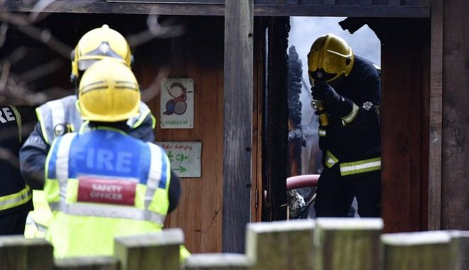 Firefighters work at the scene at Adventure cafe and shop near the Meerkat enclosure at London Zoo, London, Saturday, Dec. 23, 2017. London Zoo officials say a fire that broke out before the facility opened Saturday morning left one aardvark dead and four meerkats missing and presumed dead. Staff members were treated for smoke inhalation and shock after the blaze broke out near the zoo cafe in the early morning hours. (Dominic Lipinski/PA via AP)