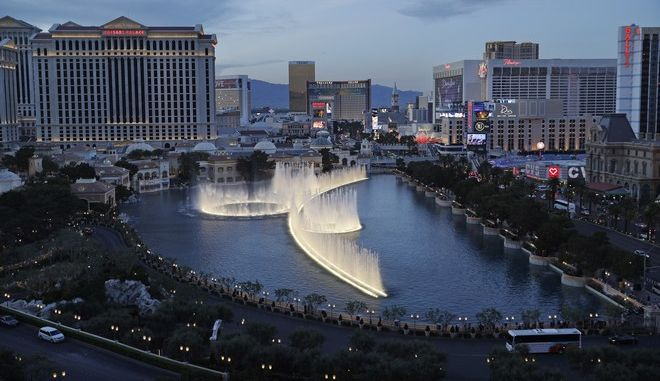 In this April 4, 2017, photo, the fountains of Bellagio erupt along the Las Vegas Strip in Las Vegas. A report from the resort's biggest travel booster released Wednesday, April 5, shows 34 percent of Las Vegas visitors in 2016 were millennials. That's up from 24 percent in 2015. (AP Photo/John Locher)