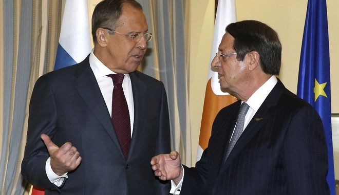 Russian foreign minister Sergey Lavrov, left, talks with Cyprus' president Nicos Anastasiades during their meeting at the presidential palace in capital Nicosia, Cyprus, on Friday, May 19, 2017. Lavrov is in Cyprus for two-day working visit. (Katia Christodoulou/Pool via AP)