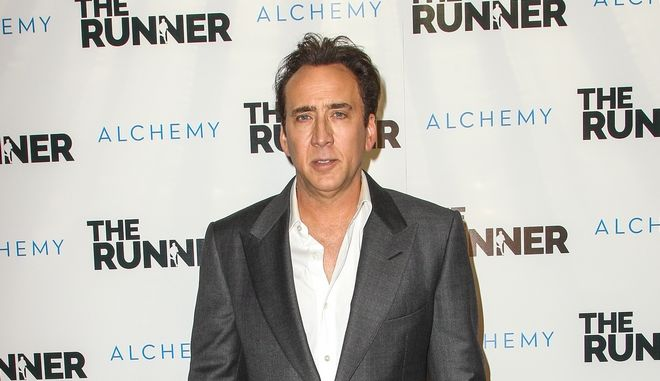 """Nicolas Cage attends a special screening of """"The Runner"""" at the TCL Chinese 6 Theatre on Wednesday, Aug. 5, 2015, in Los Angeles. (Photo by Paul A. Hebert/Invision/AP)"""